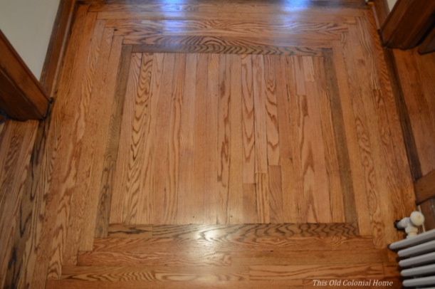 Refinished entryway landing with feature accenting herribone pattern