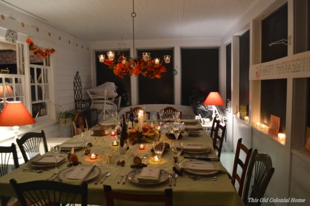 Cozy, candlelit Thanksgiving table