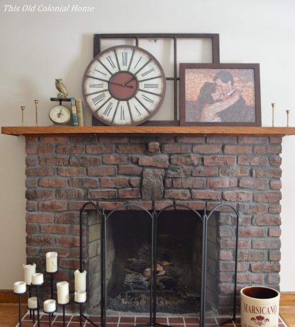 Brick fireplace with rustic mantel decor