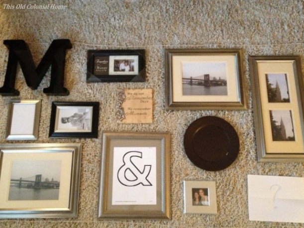 lay gallery wall pieces on floor to rearrange