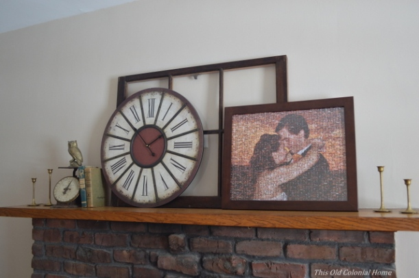 Rustic mantel with window pane and clock