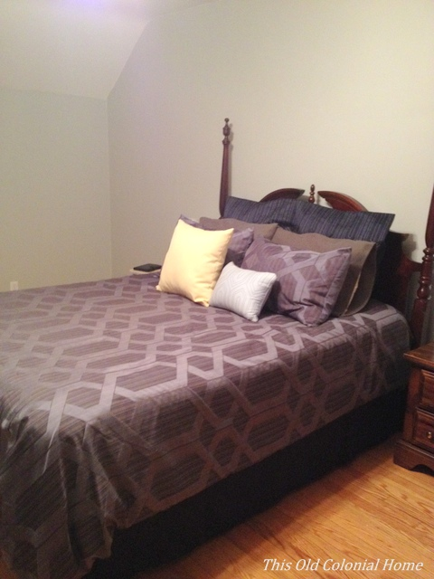 Gray walls with dark blue comforter