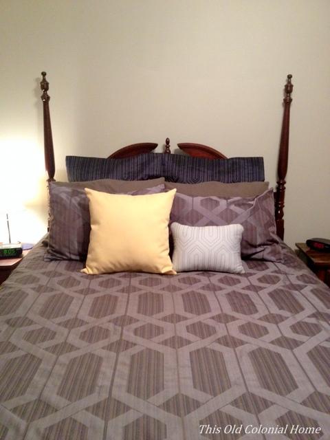 Dark blue bedding with gray walls