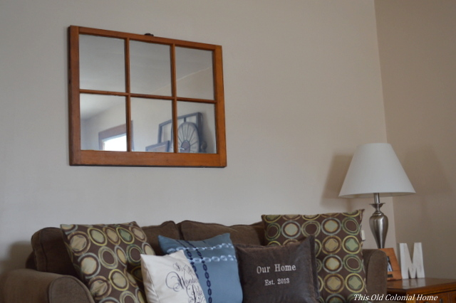 6-pane window mirror above couch