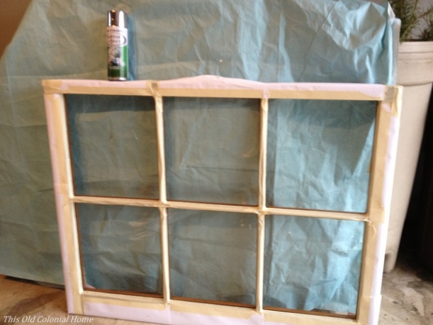 Taped off window pane for spray painting