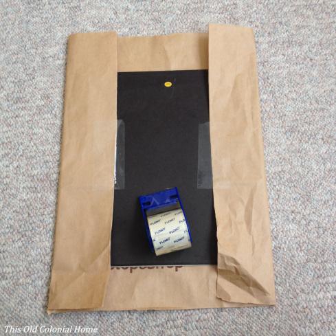 Tape bag to frame backing