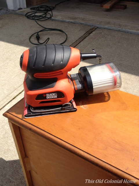Using electric sander on drawers