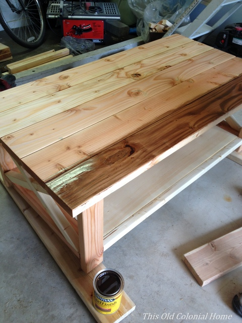 Applying the first coat of stain