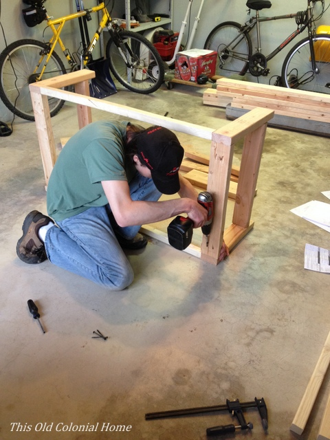 Screwing the coffee table frame together