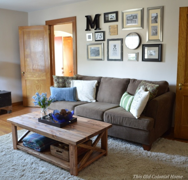 DIY wood coffee table and gallery wall in living room