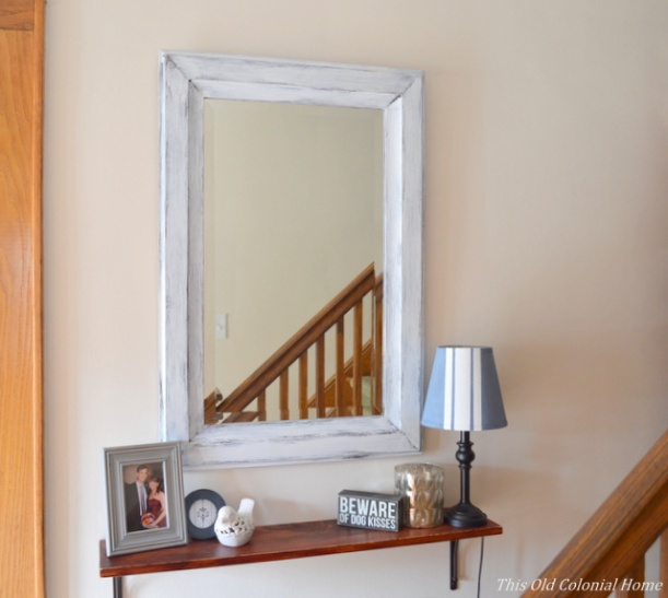 Distressed shelf and mirror in entryway