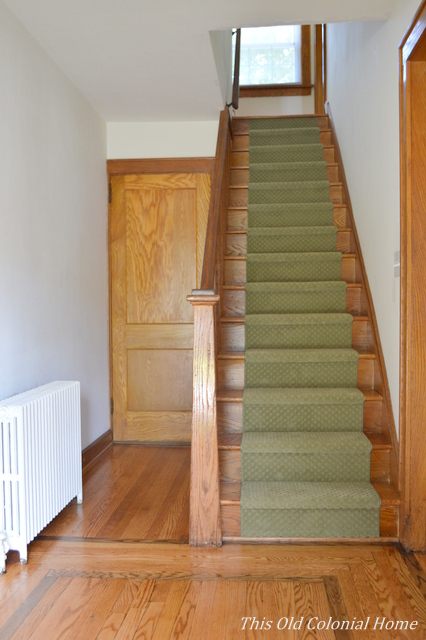 Narrow foyer with staircase and radiator