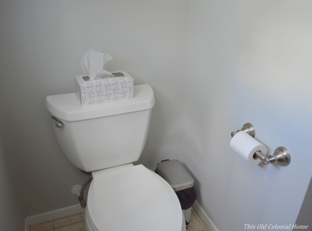 Relocated toilet paper holder