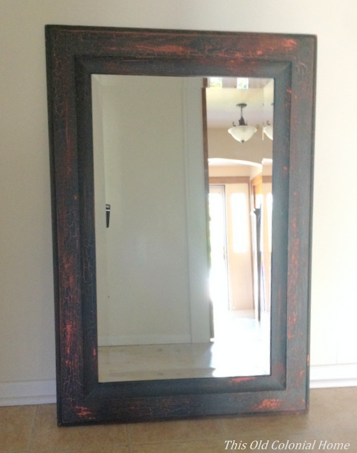 wood framed mirror with peeling paint