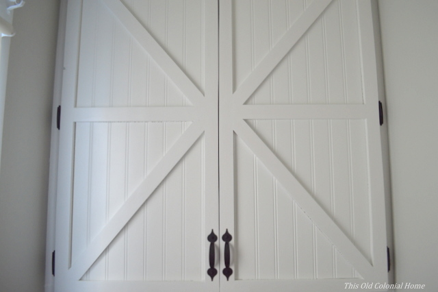 Redone bathroom cabinet doors Beadboard and x-patterned doors & beadboard | This Old Colonial Home pezcame.com