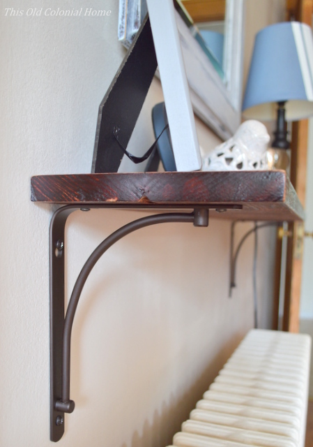 Wood shelf attached to wall with brackets