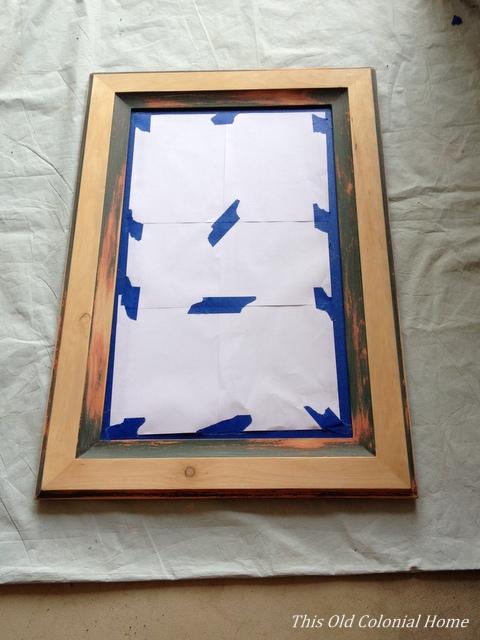 sanding a wood frame mirror