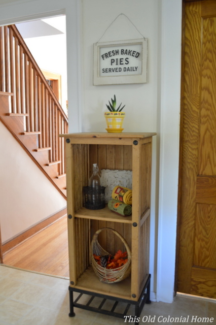 Wooden bookcase with fall decor