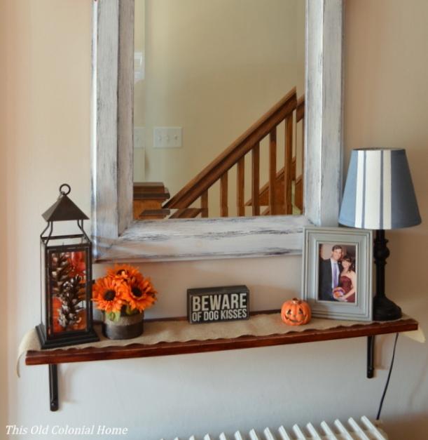 Fall shelf scape using pops of orange