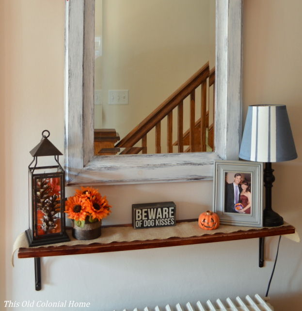 Fall shelf scape using pops of orange