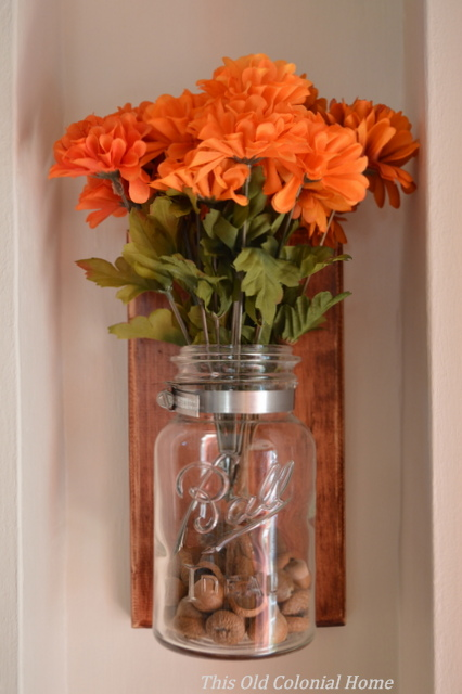 Mason jar with acorn filler and mums