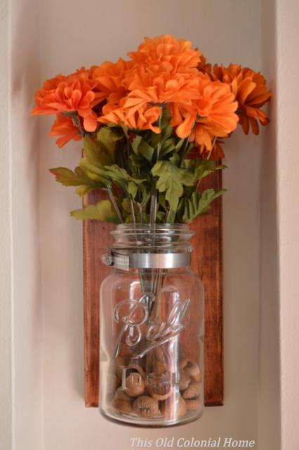 Mason jar with acorn filler and mums