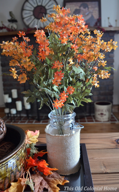 Decorate a mason jar with burlap for fall