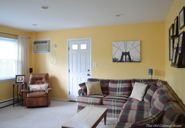Yellow family room with sectional