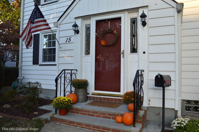 Pumpkins and mums on front steps