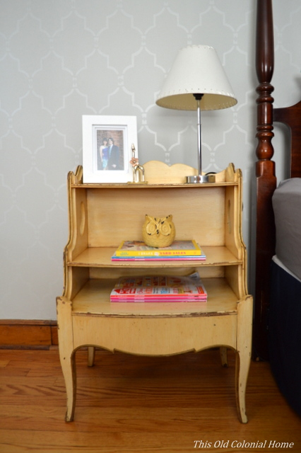 Yellow distressed nightstand found at garage sale