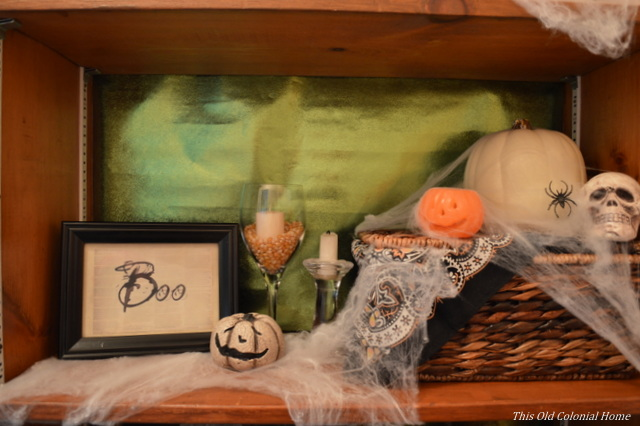 Pumpkins and boo sign shelf