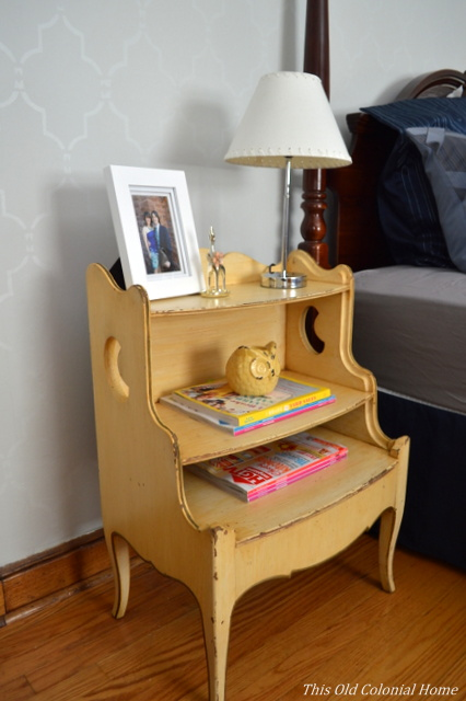Distressed nightstand with crescent cutouts