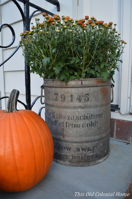 Rusty bucket turned fall planter