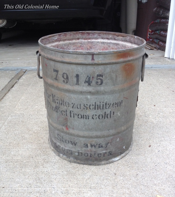 Rusty bucket with German writing