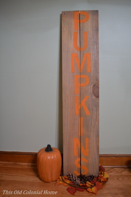 Wood sign with orange pumpkin letters