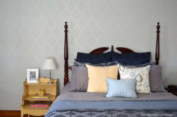 Gray and blue bedroom with yellow nightstand