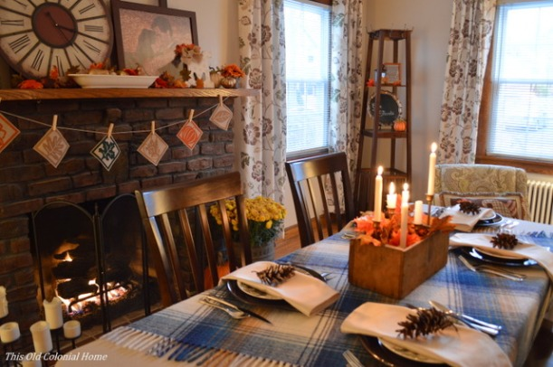Warm candlelit Thanksgiving table