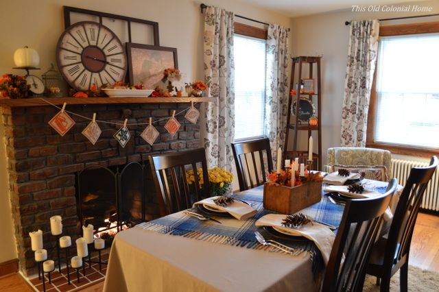 Thanksgiving table set up in living room with fireplace