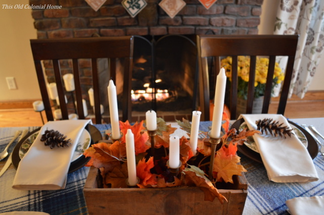 Wooden box with candles and leaves for centerpiece