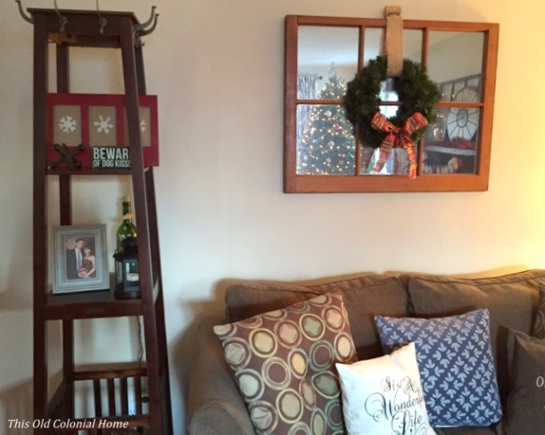 Snowflake sign and Christmas decor in living room