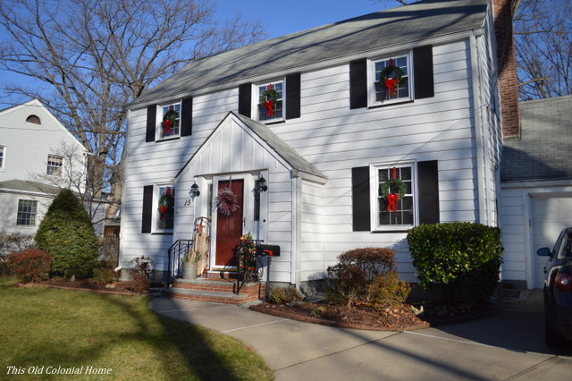 Colonial house with wreaths in windows