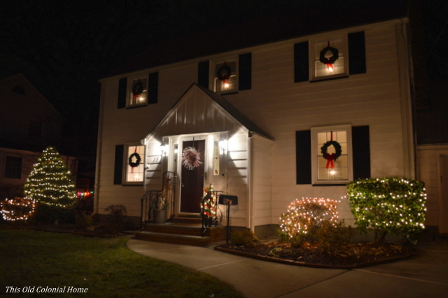 house lit up at night - Christmas Candle Lights For Windows