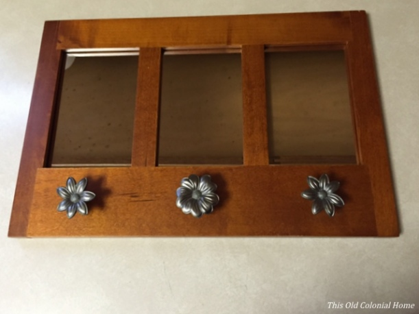 Three pane mirror with hooks