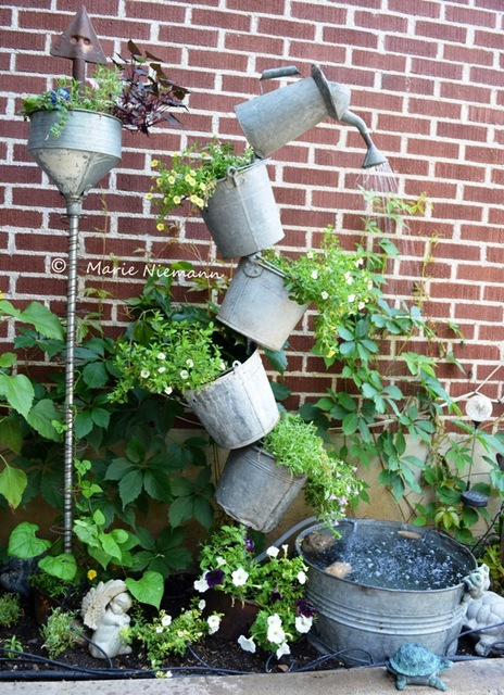 DIY tipsy fountain using buckets