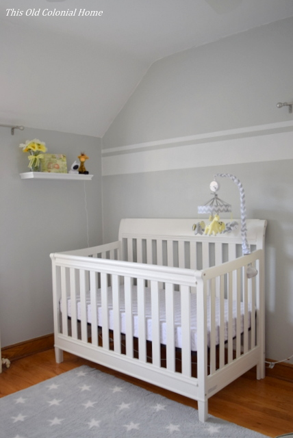 White crib in gray nursery