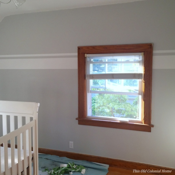White stripes in gray nursery