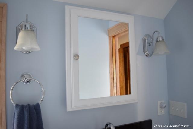 Medicine cabinet and sconce lighting