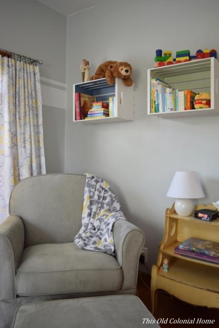 Nursery glider and book shelf crates