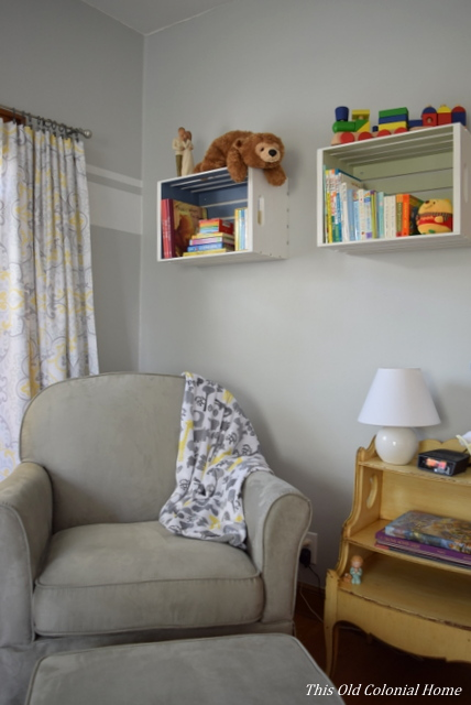 Nursery glider and book shelf crates